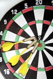 Darts on board Stock Image