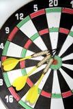 Darts on board Stock Image