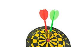 Darts board with arrows in the center. royalty free stock photo