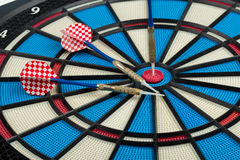 Darts board with a dart Royalty Free Stock Photo