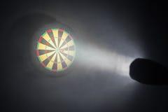 Darts board illuminated with a spotlight Royalty Free Stock Images
