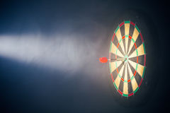 Darts board illuminated with a spotlight Royalty Free Stock Photos
