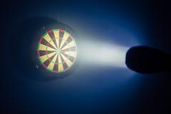 Darts board illuminated with a spotlight Stock Photo