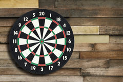 Darts board on a vintage wall Royalty Free Stock Image