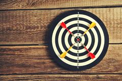 Darts Board with wooden background royalty free stock photo