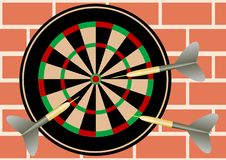 Darts on brick wall Royalty Free Stock Photo