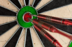 Darts in bull's eye Royalty Free Stock Image