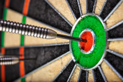 The darts in bull`s eye. The  darts in bull`s eye, close up Royalty Free Stock Images