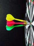 Darts on bulls eye Stock Image