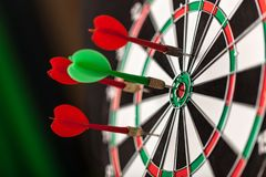 Darts in bulls-eye close up, purpose concept. Eye darts bulls close up game sport leisure Royalty Free Stock Photos