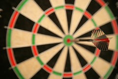 Darts in bullseye Stock Photo