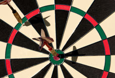 Darts on bullseye Royalty Free Stock Image