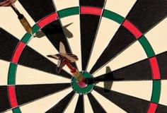 Darts on bullseye Royalty Free Stock Image