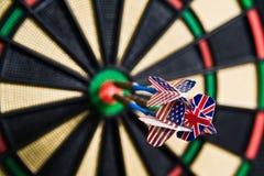 Darts on a bullseye. Three darts on a bullseye Royalty Free Stock Photos