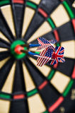 Darts on a bullseye. Three darts on a bullseye Stock Photography