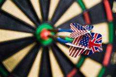 Darts on a bullseye. Three darts on a bullseye Royalty Free Stock Images