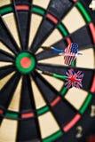 Darts on a bullseye. Two darts on a bullseye Royalty Free Stock Images
