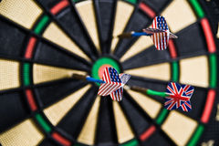 Darts on a bullseye Stock Images