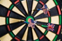 Darts on a bullseye. Three darts on a bullseye Stock Images