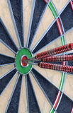 Darts in the Bullseye. Three darts in the bulls eye of a dartboard Stock Photos
