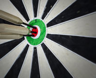 3 darts in the bullseye Royalty Free Stock Photos