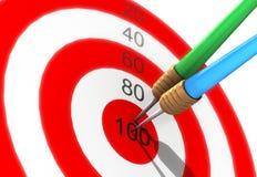 Darts in center of target Stock Photos
