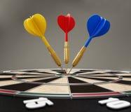 Darts at the center of the target Stock Photos