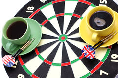 Darts coffeebreak. Game of a darts and coffee, in bright cups on a white background stock images
