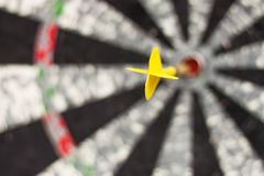 Darts concept. Close up of dart board with flight in focus Stock Photos