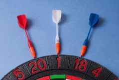 Darts and dart for throwing. On a blue background Royalty Free Stock Photography