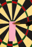Darts with dart which was pinned a sheet of paper for labels Royalty Free Stock Photo
