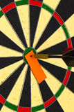 Darts with dart which was pinned a sheet of paper for labels Royalty Free Stock Photos