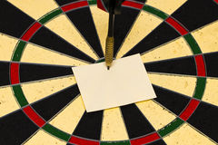 Darts with dart which was pinned a sheet of paper for labels Stock Image
