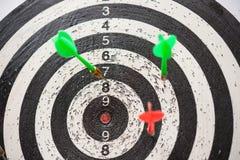 Darts and dartboard Stock Photos