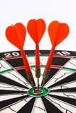 Darts and dartboard Stock Image