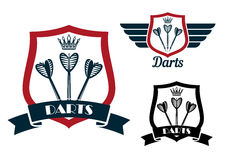 Darts emblems with arrows on shields Stock Images