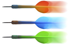 Darts flying swift. Three swift flying darts in the air with motion blur Royalty Free Stock Image