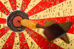 Darts Game. A game of darts with a dart in the bullseye of the dart board Stock Photos