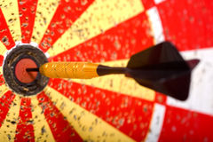 Darts Game. A game of darts with a dart in the bullseye of the dart board Stock Photography