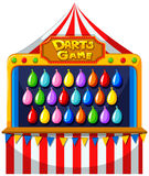 Darts game with balloons on the wall Stock Images