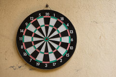 Darts. Game of darts target on wall in garden Royalty Free Stock Image
