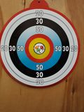 Of Darts game is to hit a round bright digits on a wooden door royalty free stock photos