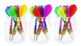 Darts in Glass Jars Stock Image