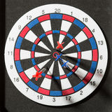Darts hit dartboard. Red and blue darts hit dartboard Royalty Free Stock Images
