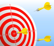 Darts hit the red target. Yellow darts hit the red target. One dart hit the bull's-eye Royalty Free Stock Image