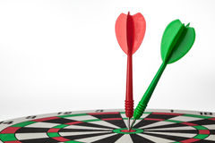 Darts hit target Stock Photos