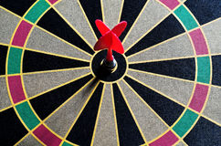 Darts hit the target in bull Royalty Free Stock Images
