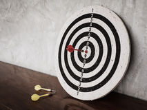 Darts hit target on dartboard Stock Photos