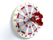 Darts hitting bulls eye Stock Photography