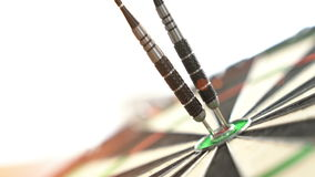 Darts hitting the bulls eye on stock video footage